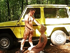 After heaps of risqu oral clash, these guys take it in turns to fuck each other on and around Darren's Jeep before cumming all over eac